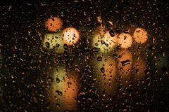 Drops of water on a glass street light. Stock Image