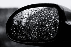 Drops of water on mirror. Drops of water on a car mirror. Black and white Royalty Free Stock Photography