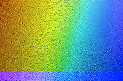 Drops of water on a rainbow background. Royalty Free Stock Images