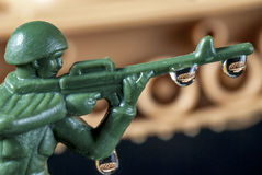 Plastic Army Man with drops and tank reflection. Drops of water reflection of a tank and army man Royalty Free Stock Photography