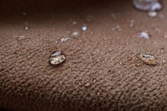 Drops of water on a water resistant fabric Stock Photography