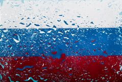 Drops of water on Russian flag background. Shallow depth of field. Selective focus. Toned. Top view. Full frame. Abstract flag pattern concept image royalty free stock photography