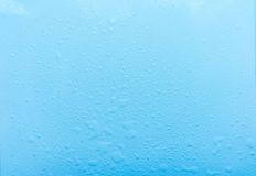 Drops, water splashes on blue background. Cute simple background, backdrop. Top view. Close-up. Stock photo Royalty Free Stock Photo