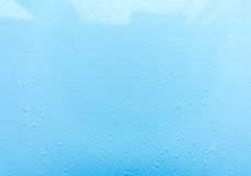 Drops, water splashes on blue background. Cute simple background, backdrop. Top view. Close-up. Stock photo Stock Images