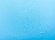 Drops, water splashes on blue background. Cute simple background, backdrop. Top view. Close-up. Stock photo Royalty Free Stock Photos