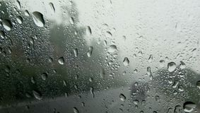 DROPS OF WATER ON A WINDOW OF CAR royalty free stock photos