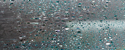 Drops of water. Water on the windshield taken a rainy day in March Royalty Free Stock Image