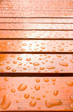 Drops of water on wooden. Chair Royalty Free Stock Image
