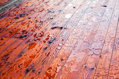 Drops of water on the wooden floor Royalty Free Stock Photo