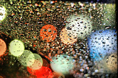 Drops on Window. Rain drops on window with colorful lights outside Stock Photos