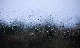 Drops on window blurred background stock photos