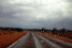 Drops on windscreen. Rain on the road highway somewhere in outback, South Australia Royalty Free Stock Photo