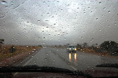 Drops on windscreen. Rain on the road highway somewhere in outback, South Australia Stock Photo