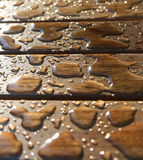 Drops on a wooden surface. After a rain Stock Photo