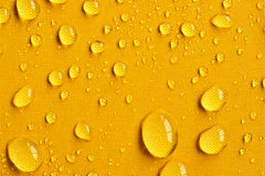 Drops on Yellow Umbrella. Close up of drops on yellow umbrella stock photos