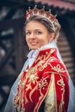 Drottning i den röda klänningen royaltyfri fotografi