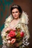 Drottning i kunglig klänning royaltyfria foton