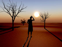 Drought. Due to climate change and global warming. Woman lost her harvest and animals Royalty Free Stock Photography