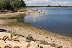 Drought in Colorado. Boats sit further and further from the bank of a drying up reservoir in Loveland Colorado Royalty Free Stock Photos