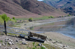 Drought Conditions - Floating Pier on Ground at Empty Reservoir Royalty Free Stock Images