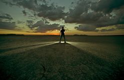 Drought Confrontation. / Men in Light - Men in Front of Some Mystique Light on Desert. Creative Photography Photo Collection royalty free stock photo