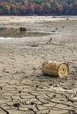 Drought Disaster. A long term drought takes its tole on a lake in Atlanta.  A dried up lake bed exposes dried red clay and trash Royalty Free Stock Photography