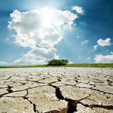 Drought earth and sun in sky. Drought earth and sun in cloudy sky Stock Images