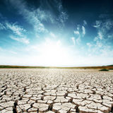 Drought earth and sunset in dark sky Stock Photo
