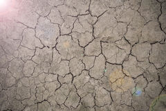Drought floor with light of hope Stock Photos
