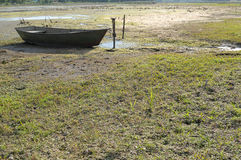 Drought in the hot summer. Dried river and rest on land Boat Royalty Free Stock Photo