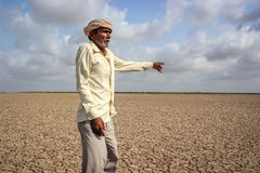 Drought - India. A farmer showing drought effected land in Mahrasthra state of India where hundreds of farmers commit suicide every year due to financial crisis Stock Images