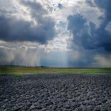 Drought land and dramatic sky Stock Photos
