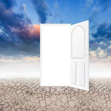 Drought land with an open door in white background Stock Images