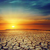 Drought land and sunset Royalty Free Stock Image