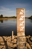 Drought markers. Welford reservoir is so empty that two measuring poles are fully revealed royalty free stock images