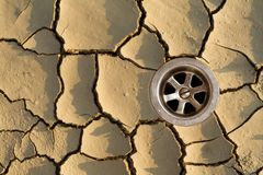 The drought puzzle - solved. The missing piece of the drought puzzle - the sewer - nice raindrop craters on the pieces royalty free stock photos