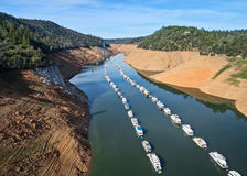Drought-stricken Northern California. Boats lined up in a narrow arm of Lake Oroville, California Stock Photo