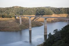 Drought-stricken resevoir in California at New Melones Lake. The New Melones Lake in the Sierra Foothills of California at very low levels during recent drought Stock Photography