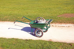 Drought: watering cans in a wheelbarrow Royalty Free Stock Image