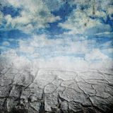 Droughts desert and cloudy sky. Over grunge background Stock Photography