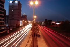 Drove by the light. Cars, longexposure, building, yellow stock photography