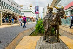 Drover statue with donkey in the commercial center. ARMENIA, COLOMBIA - FEBRUARY 23, 2015: Drover statue with donkey in the commercial center of Armenia Royalty Free Stock Photography