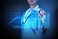 Drowing Mediendiagramme der Geschäftsfrau Stockfoto