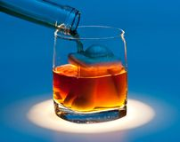 Drown in a glass of alcohol Stock Photography