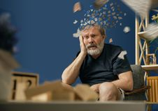 Old bearded man with alzheimer desease. Drown image of losing of mind. Old bearded man with alzheimer desease sitting and suffering from headache. Illness stock photos