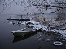 Drowned boat. Winter lake landscape royalty free stock photo