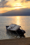 Drowned boat at sunrise. Drowned boat near gili meno, indonesia in the early morning during Royalty Free Stock Photos