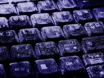 Drowned Business. A laptop keyboard under water for a long time - with little bubbles on the keys and all this colorized in blue. Can be used to express things stock image
