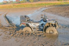 Drowned in the mud. ATV drowned in the mud Royalty Free Stock Photography