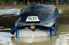 Drowned tuk-tuk taxi in Thailand Royalty Free Stock Image